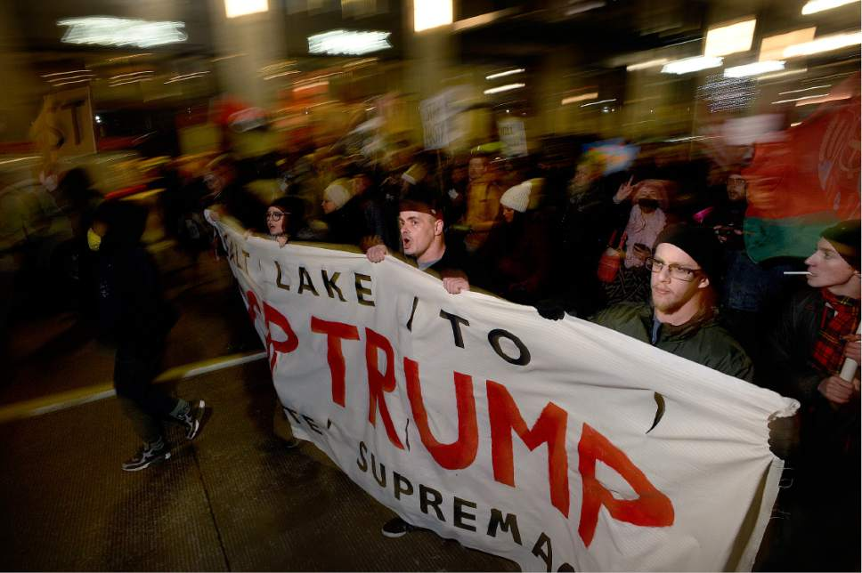 Scott Sommerdorf   |  The Salt Lake Tribune   Protestors march up South Temple toward the Capitol building protesting the inauguration of Donald Trump, Friday, January 20, 2017.