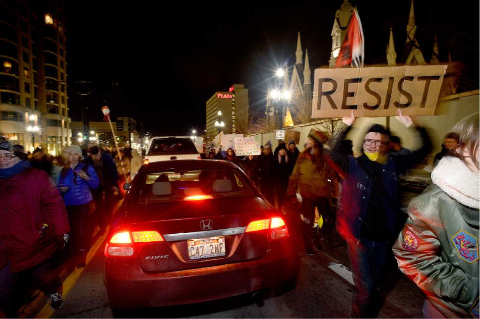 Scott Sommerdorf   |  The Salt Lake Tribune   Protestors briefly stopped traffic on South Temple as they marched toward the Capitol building protesting the inauguration of Donald Trump, Friday, January 20, 2017.