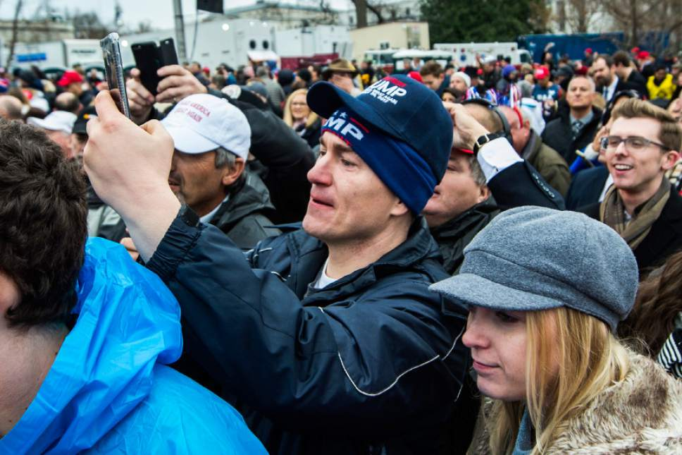 Chris Detrick  |  The Salt Lake Tribune Robert and Anna Woodruff, of South Jordan, watch and take pictures during the 58th Presidential Inauguration Ceremony at the U.S. Capitol Friday January 20, 2017.
