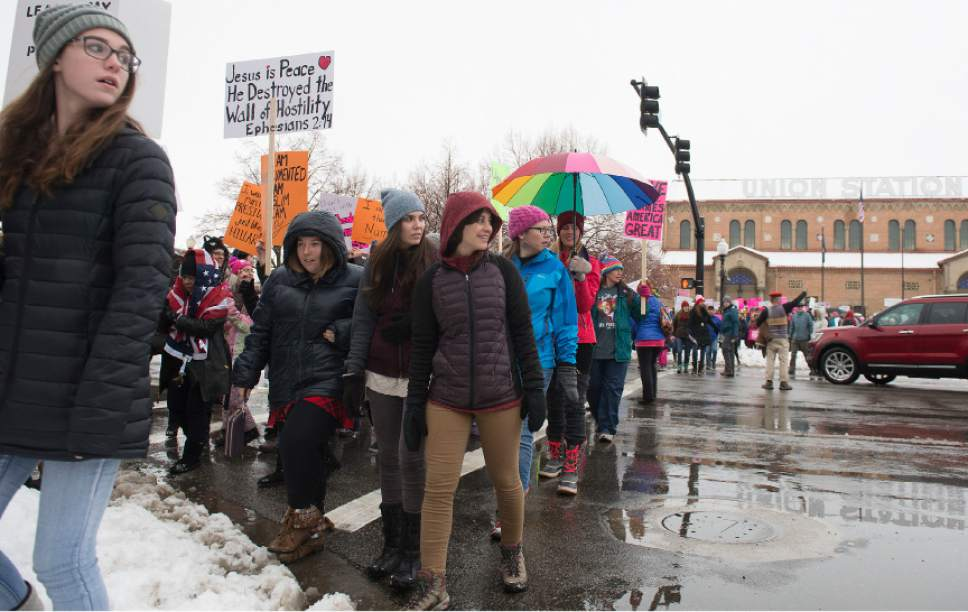 Leah Hogsten  |  The Salt Lake Tribune Ogden march participants were treated to upset drivers who had to stop for them to pass along Wall Avenue, some who flashed inappropriate gestures. In conjunction with the Women's March on Washington, Ogden hosted the Northern Utah Unity Rally Saturday, January 21, 2017  at Ogden Union Station with a march to Washington Boulevard, ending at the Ogden City Municipal Building, 2549 Washington Blvd.