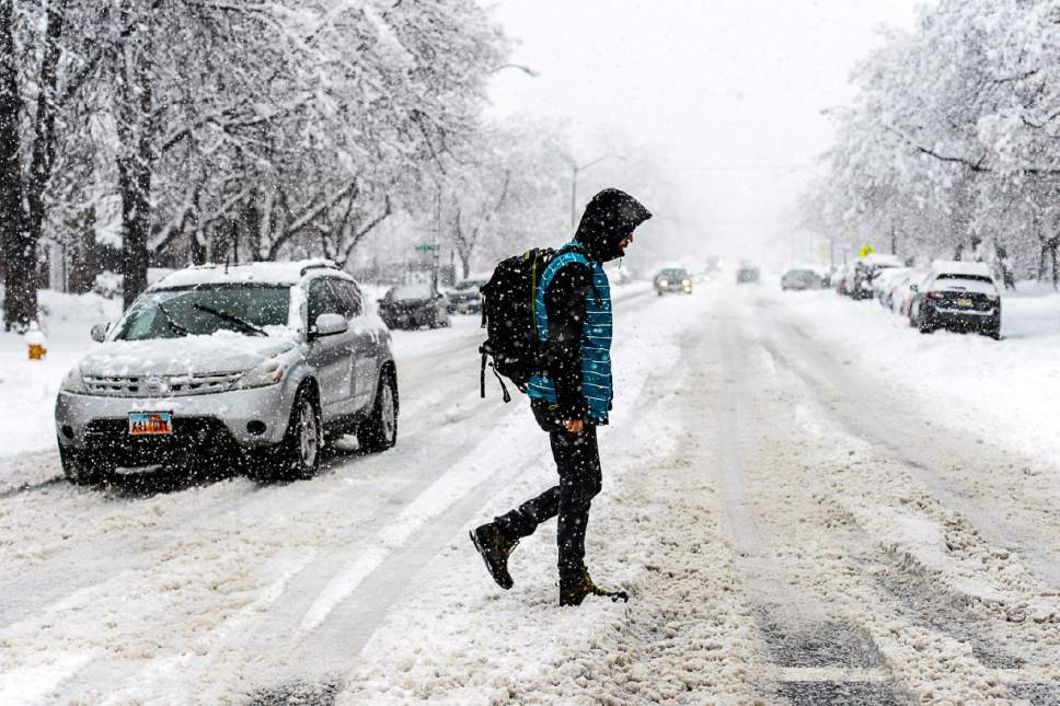 Trent Nelson  |  The Salt Lake Tribune A pedestrian crosses 300 South at 700 East as a snowstorm hits Salt Lake City, Saturday January 21, 2017.