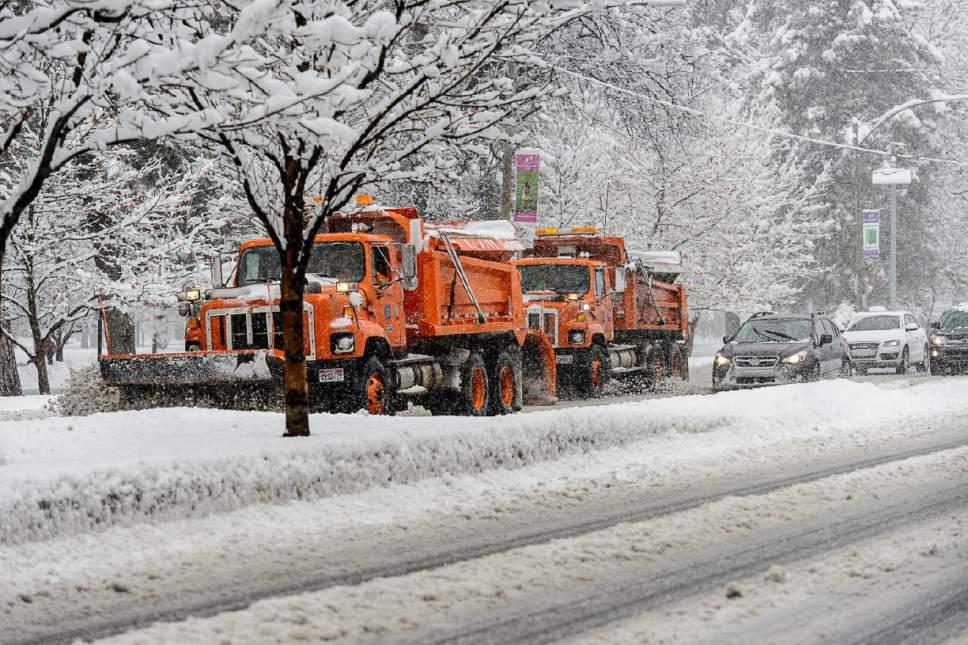 Trent Nelson     The Salt Lake Tribune Snowplows on 700 East as a snowstorm hits Salt Lake City, Saturday January 21, 2017.