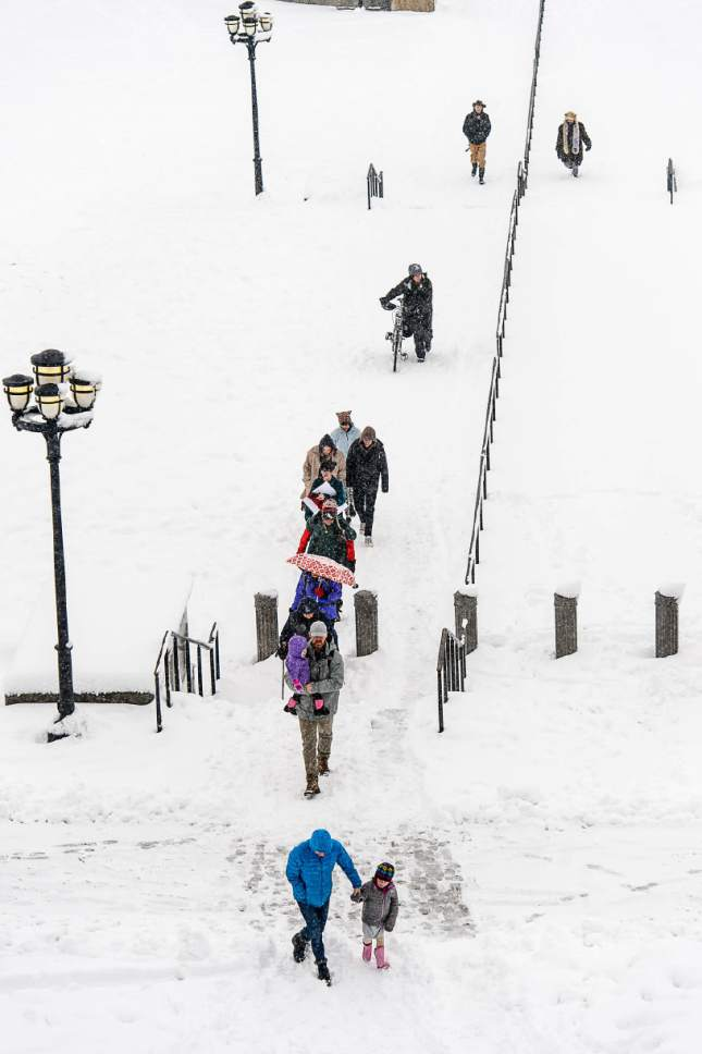 Trent Nelson     The Salt Lake Tribune People walking to the State Capitol Building for a clean air rally as a snowstorm hits Salt Lake City, Saturday January 21, 2017.