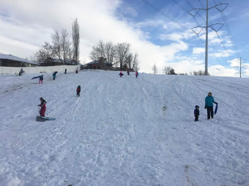 Mariah Noble     The Salt Lake Tribune  Families in Murray enjoy the winter weather by sledding Saturday, Jan. 21, 2017.