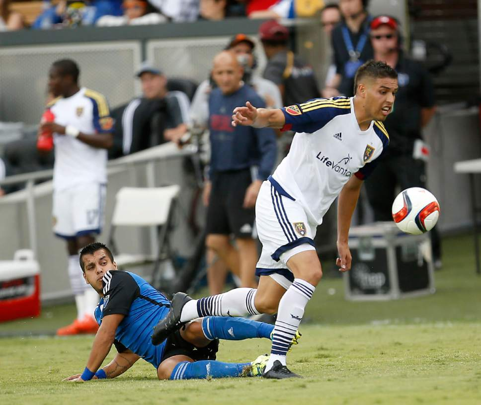 Real Salt Lake midfielder Luis Silva, right, takes the ball away from San Jose Earthquakes midfielder Matias Perez Garcia (10) during the second half of an MLS soccer match, Sunday, Sept. 27, 2015, in San Jose, Calif. San Jose won 1-0. (AP Photo/Tony Avelar)