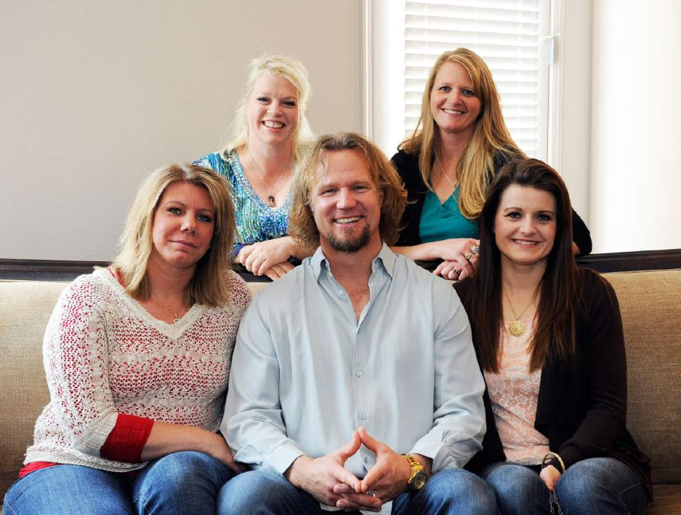"""Jerry Henkel       The Associated Press Kody Brown sits with his wives in July at one of their homes in Las Vegas. They are the polygamist family featured on TLC's """"Sister Wives"""" program.  Pictured are: top row, Janelle, left, and Christine; bottom row, Meri, left, Kody and Robyn."""