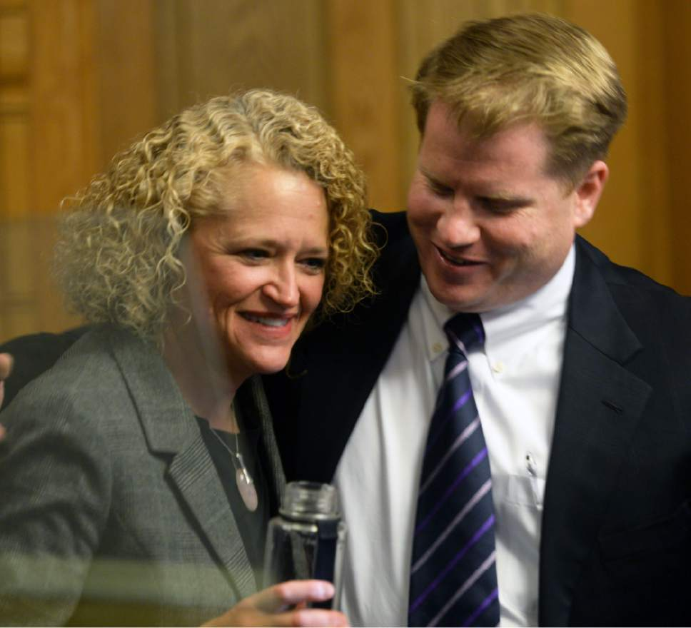 Steve Griffin / Tribune file photo  Salt Lake City Mayor Jackie Biskupski gets a hug from City Council Chairman James Rogers after she detailed her budget for the fiscal year on Tuesday, May 3, 2016. But things have gotten more tense lately as the new mayor and council tangle over proposed new homeless shelters in the city.