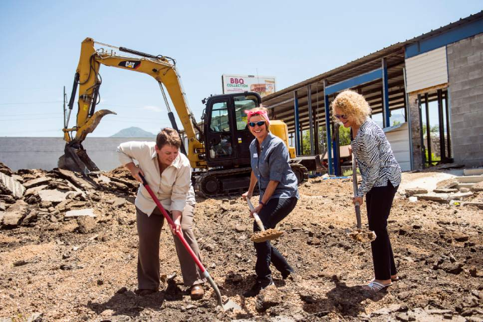 Chris Detrick  |  The Salt Lake Tribune Mayor Jackie Biskupski, Council Member Lisa Adams, and Sugar House Community Council Chair Amy Barry shovel dirt during a press conference at Ute Car Wash in Sugar House Wednesday July 6, 2016.