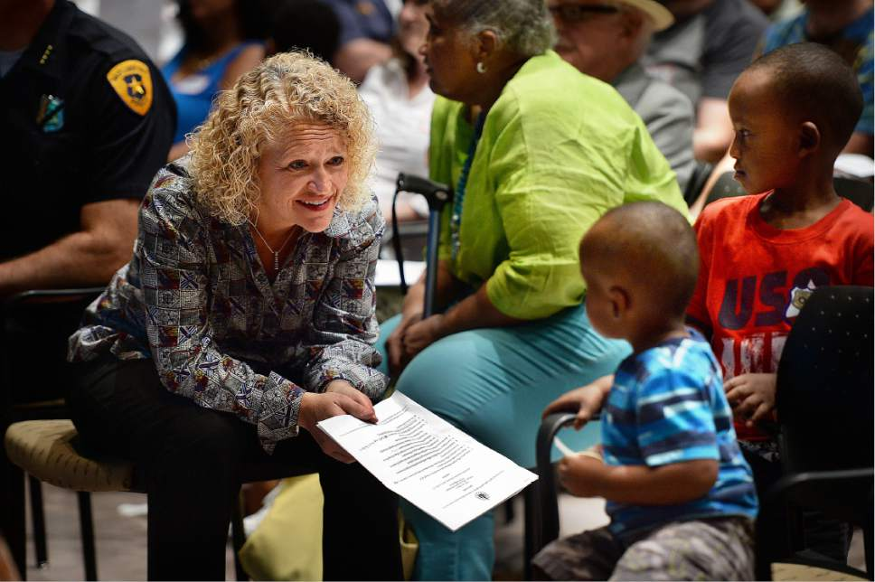 "Scott Sommerdorf   |  The Salt Lake Tribune   Salt Lake City Mayor Jackie Biskupski, speaks with two young men during a public engagement workshop called ""Transforming Together,"" at the Sorenson Unity Center, Thursday, July 21, 2016."