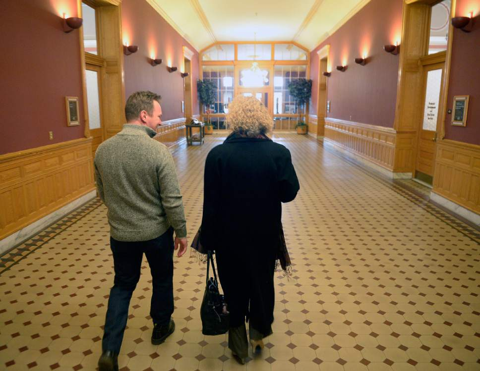 Al Hartmann  |  The Salt Lake Tribune Mayor-elect Jackie Biskupski walks with Councilman-elect Andrew Johnston in Salt Lake City Hall.