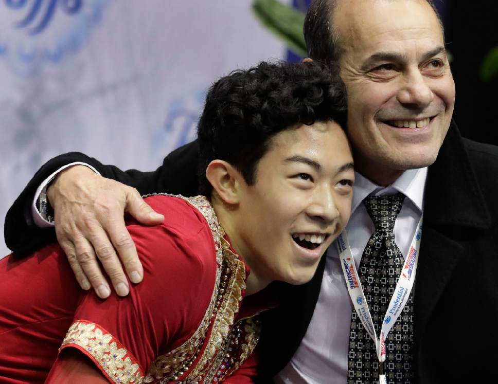 Nathan Chen celebrates with his coach Rafael Arutyunyan after performing in the men's free skate competition at the U.S. Figure Skating Championships Sunday, Jan. 22, 2017, in Kansas City, Mo. (AP Photo/Charlie Riedel)