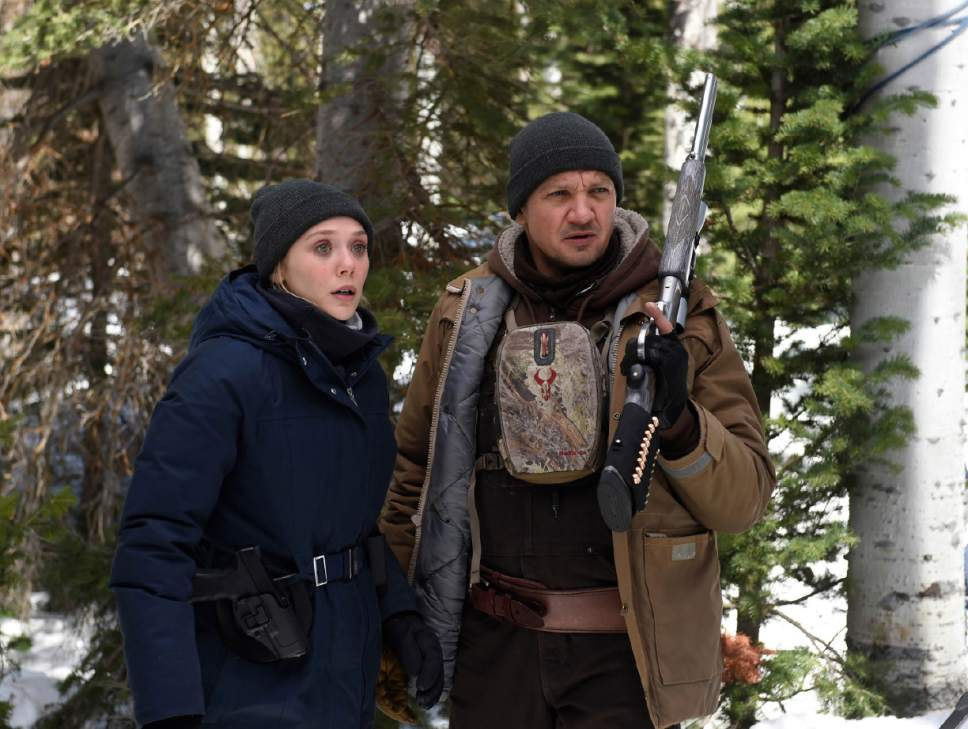 """A rookie FBI agent (Elizabeth Olsen, left) and a veteran tracker (Jeremy Renner) team up to solve a case in writer-director Taylor Sheridan's crime drama """"Wind River."""" The movie, filmed in and around Park City, will debut in the Premieres section of the 2017 Sundance Film Festival. Courtesy Sundance Institute"""