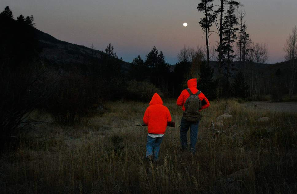 Scott Sommerdorf   |  The Salt Lake Tribune Twelve year old Grayden Larson and his father Aaron of Bluffdale head out on their first hunting trip together as they hunt near Soapstone Basin just off the Mirror Lake Highway, early Saturday morning, October 19, 2013.