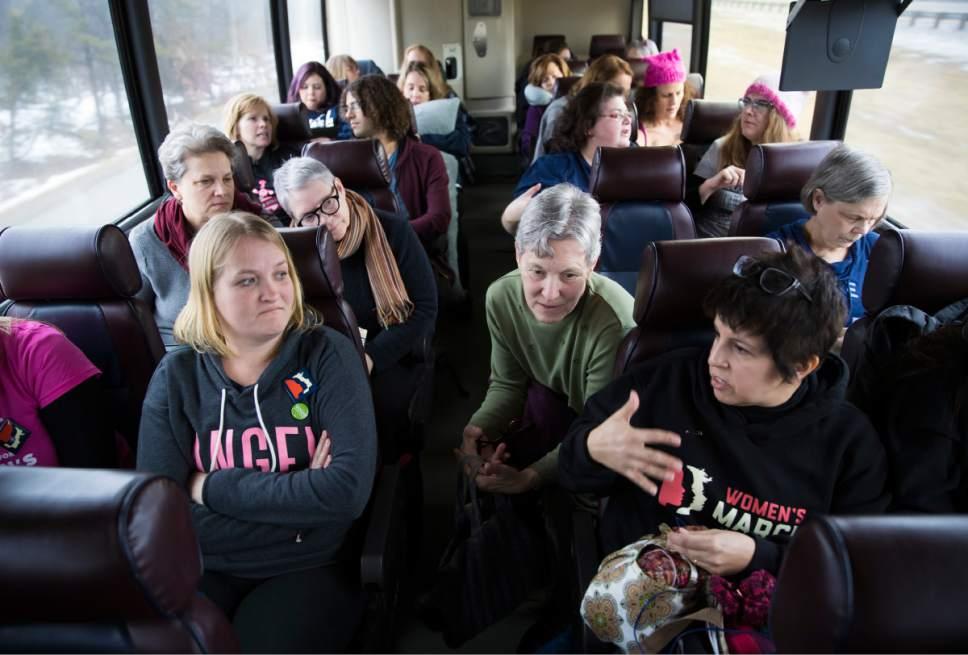 Women ride a bus to Washington for the Women's March, Friday, Jan. 20, 2016, in Minneapolis, Minn. (Renee Jones Schneider/Star Tribune via AP)