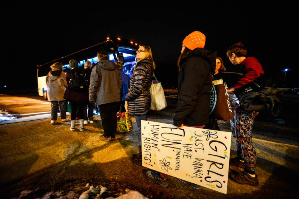 Rachelle Beaudoin, of Peterborough, N.H., waits in line to board the bus at Dillant–Hopkins Airport, in Keene, N.H., on Friday, Jan. 20, 2017, that will head to Washington for the Women's March on Saturday. (Kristopher Radder/The Brattleboro Reformer via AP)