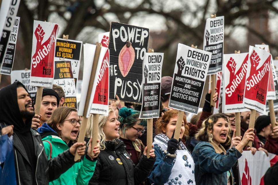 Chris Detrick  |  The Salt Lake Tribune Attendees march from the National Mall to The White House during the Women's March on Washington  Saturday January 21, 2017.