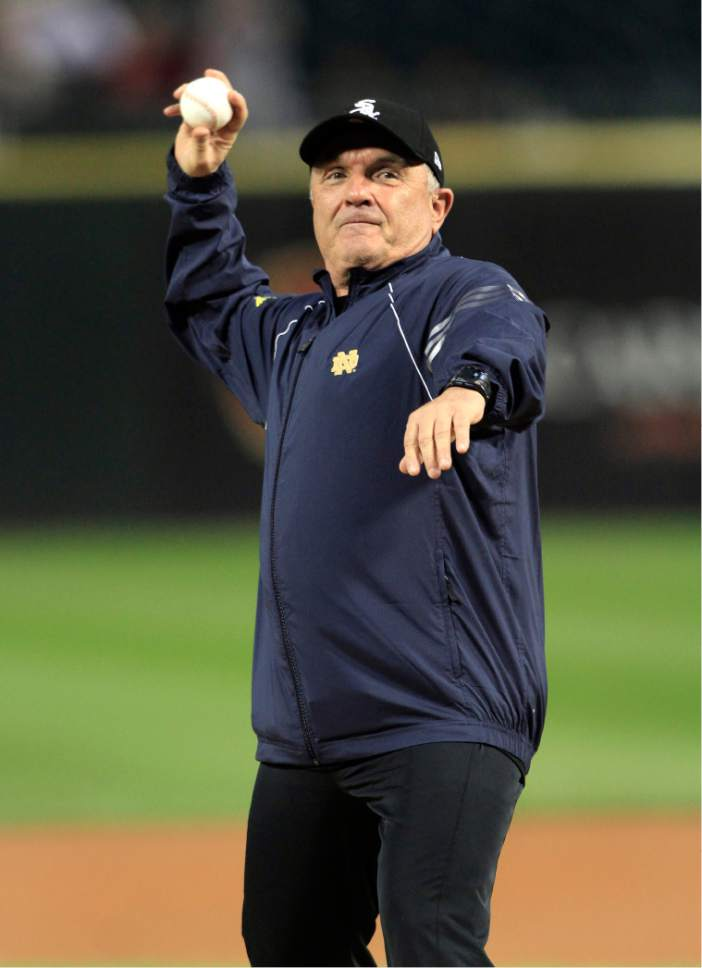 Former Notre Dame football player Rudy Ruettiger throws out the ceremonial  first pitch before the Chicago b95354caf
