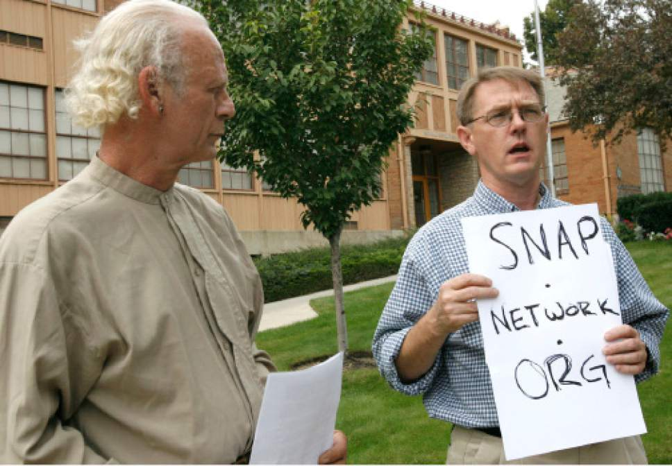 Rick Egan  |  The Salt Lake Tribune  L-R Robert Brooks and David Clohessy speak outside the Catholic Diocese on September 7, 2006. Brooks and Clohessy are calling for the diocese to post on its Web site the names of any clergy who have been disciplined in any way related to abuse allegations.