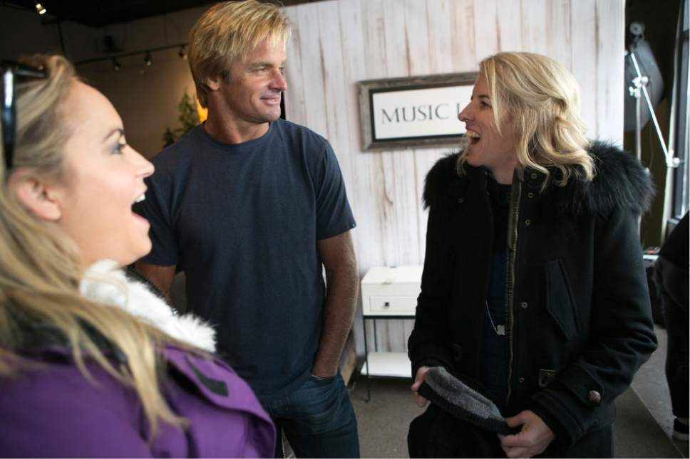 Actor Laird Hamilton, center, and director Rory Kennedy, right, answer questions during an interview with Cindy Matalucci from The Pulse at the Music Lodge during the Sundance Film Festival on Sunday, Jan. 22, 2017, in Park City, Utah. (Photo by Jud Burkett/Invision for The Music Lodge/AP Images)