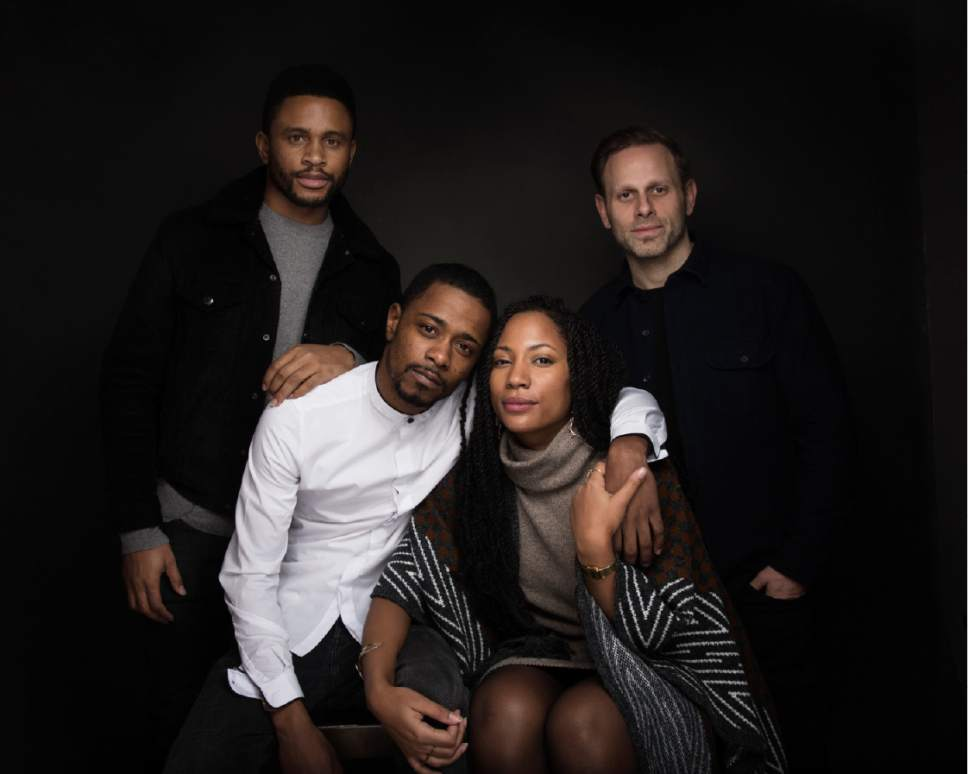 """Actor Nnamdi Asomugha, from left, Lakeith Stanfield, Natalie Paul and Writer/director Matt Ruskin pose for a portrait to promote the film, """"Crown Heights"""", at the Music Lodge during the Sundance Film Festival on Monday, Jan. 23, 2017, in Park City, Utah. (Photo by Taylor Jewell/Invision/AP)"""