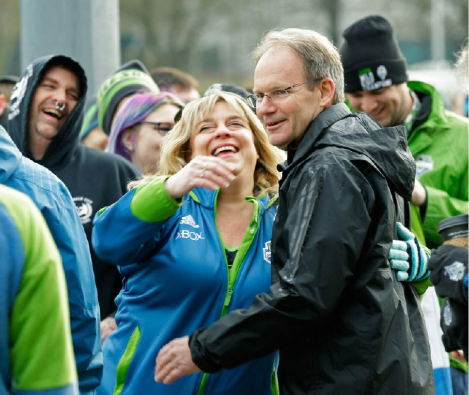 Seattle Sounders head coach Brian Schmetzer gets a hug as he greets fans before the first training session of the 2017 MLS soccer season, Tuesday, Jan. 24, 2017, in Tukwila, Wash. (AP Photo/Ted S. Warren)