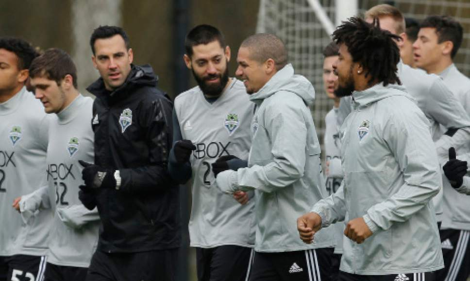 Seattle Sounders including forward Clint Dempsey, center, and team captain midfielder Osvaldo Alonso, second from right, jog during the first training session of the 2017 MLS soccer season, Tuesday, Jan. 24, 2017, in Tukwila, Wash. (AP Photo/Ted S. Warren)