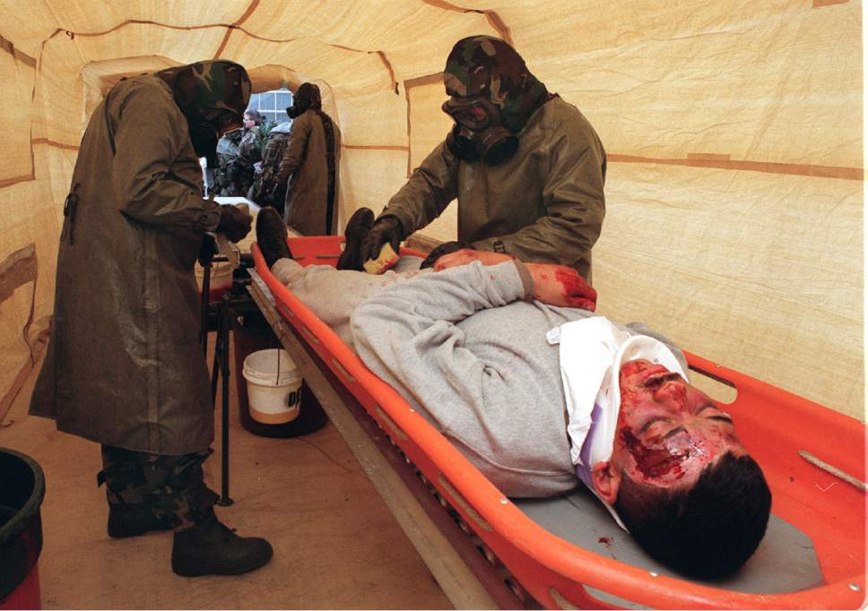 New technologies for detecting, sampling and identifying biological weapons were demonstrated today at Dugway. Here a Marine Decomtamination Platoon from N. Carolina decomtaminates a victim.  Ryan Galbraith/photo