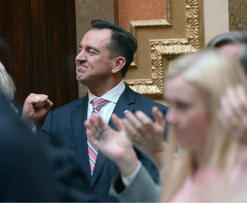 Al Hartmann  |  The Salt Lake Tribune Speaker of the House Greg Hughes pumps his fist as he is applauded by members of the House of Representatives before taking the oath of office Monday Jan. 23 during the first day of the 2107 Legislative session at the Utah State Capitol.