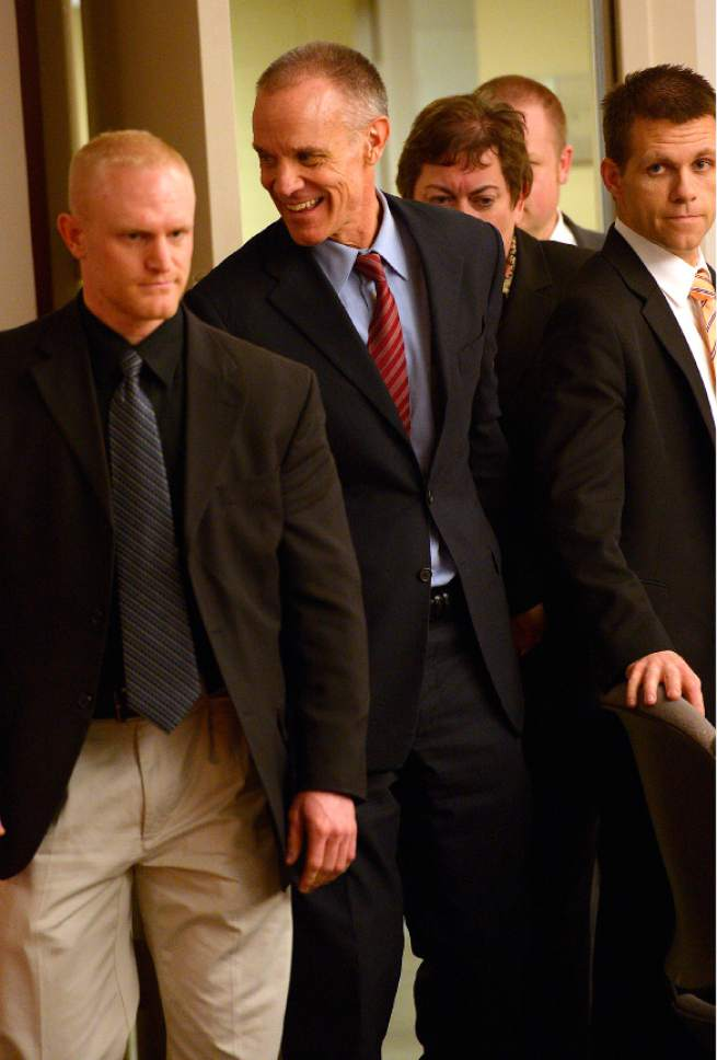 Leah Hogsten  |  The Salt Lake Tribune Marc Sessions Jenson smiles at three family members as he enters the courtroom to hear the verdict. Jenson was found not guilty Friday, January 30, 2015 of fraud and money laundering in connection with the failed Mount Holly golf and ski resort near Beaver ó a case with ties to the bribery and corruption investigation of former Utah attorneys general Mark Shurtleff and John Swallow. Following a three-week trial, a jury of five men and three women deliberated 14 hours over two days before acquitting Jenson of four counts each of second-degree felony communications fraud and money laundering.