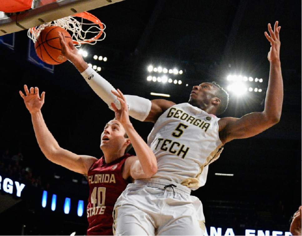 Florida State forward Brandon Allen (40) and Georgia Tech guard Josh Okogie (5) vie for a rebound during the second half of an NCAA basketball game Wednesday, Jan. 25, 2017, in Atlanta. Georgia Tech won 78-56. (AP Photo/John Amis)
