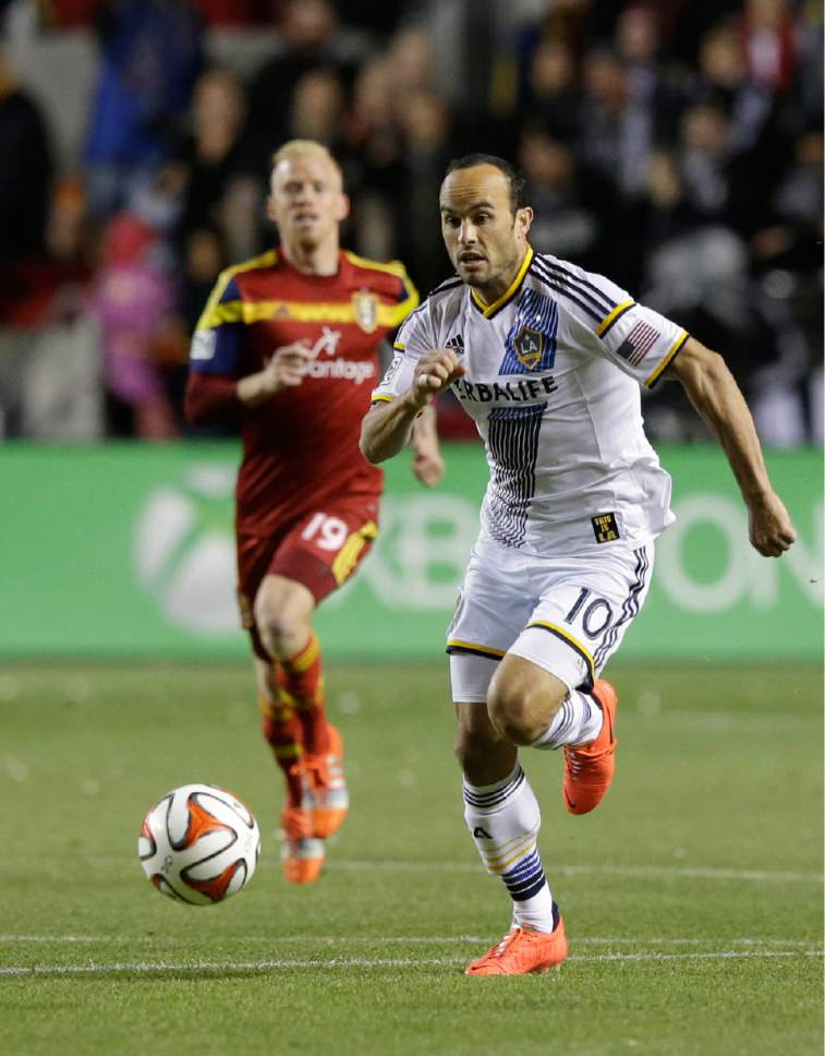 Los Angeles Galaxy's Landon Donovan (10) brings the ball up field in the first half during an MLS Western Conference semifinal, first leg playoff soccer match against Real Salt Lake Saturday, Nov. 1, 2014, in Sandy, Utah. Real Salt Lake and the Los Angeles Galaxy tied 0-0. (AP Photo/Rick Bowmer)