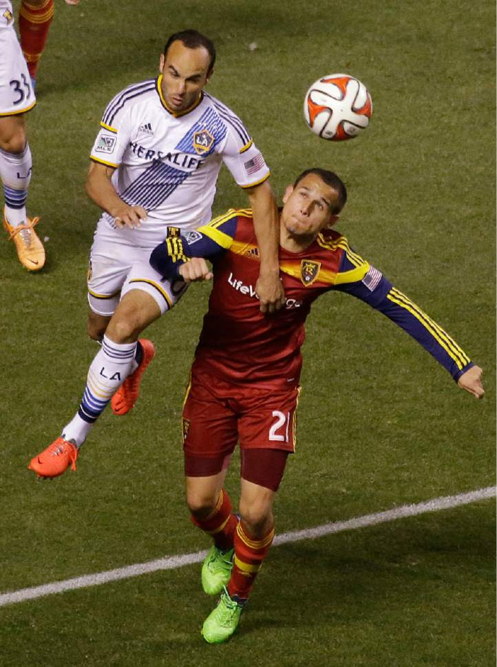 Los Angeles Galaxy's Landon Donovan (10)  and Real Salt Lake midfielder Luis Gil (21) battle for the ball in the second half during an MLS Western Conference semifinal, first leg playoff soccer match Saturday, Nov. 1, 2014, in Sandy, Utah. Real Salt Lake and the Los Angeles Galaxy tied 0-0. (AP Photo/Rick Bowmer)