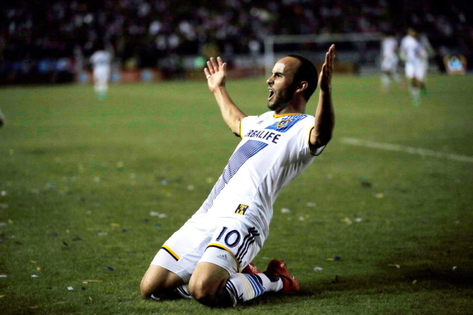 Los Angeles Galaxy's Landon Donovan celebrates scoring a goal against Real Salt Lake during the second half of an MLS soccer Western Conference playoff series game, in Carson, Calif., Sunday, Nov. 9, 2014. (AP Photo/Danny Moloshok)