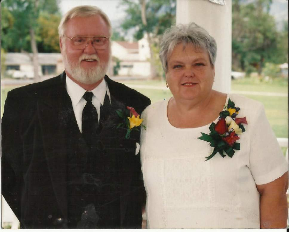 """Leroy """"Woody"""", 70, and Dorotha Ann Fullwood, 69, pose at a wedding reception for one of their children. Police found the Fullwood couple dead in their Mt. Pleasant home on New Year's Eve. Police have since arrested the duo wanted in connection with a two-state crime spree that left the Fullwoods dead and another seriously wounded. Courtesy Fullwood Family"""