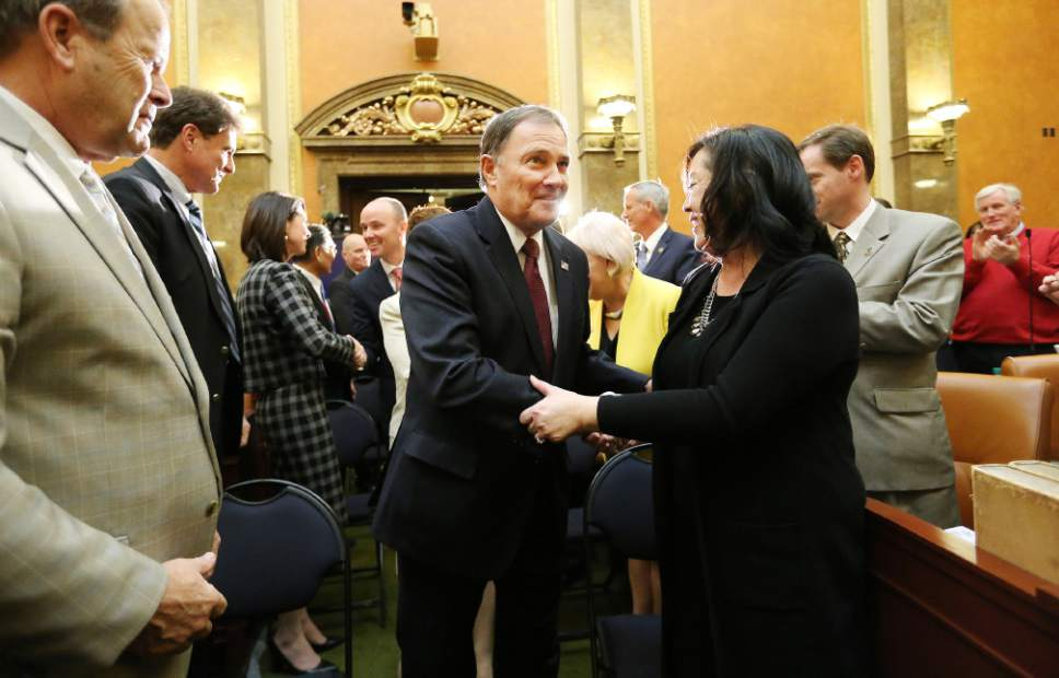 Jeffrey D. Allred  |  Pool Photo  Gov. Gary R. Herbert shakes hands with Sen. Jani Iwamoto, D-Holladay, prior to his State of the State address at the Utah State Capitol in Salt Lake City on Wednesday, Jan. 25, 2017.