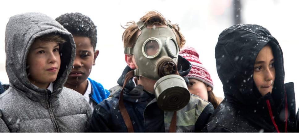 Steve Griffin / The Salt Lake Tribune  Madeleine Choir School fifth- grader Oliver Laughlin wears a gas mask as he and hundreds of Utah students from schools including the Choir School, Rowland Hall and Judge Memorial Catholic High School participate in a Clean Air Rally on the front steps of the State Capitol in Salt Lake City Thursday January 26, 2017. This is the third consecutive year students from the Choir School have aired their concerns about the excess smog as several students gave speeches to the group.