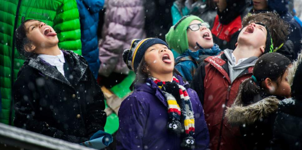 Steve Griffin / The Salt Lake Tribune  Children try and catch snow flakes on their tongues as hundreds of Utah students from schools including the Madeleine Choir School, Rowland Hall and Judge Memorial Catholic High School participate in a Clean Air Rally on the front steps of the State Capitol in Salt Lake City Thursday January 26, 2017. This is the third consecutive year students from the Choir School have aired their concerns about the excess smog as several students gave speeches to the group.