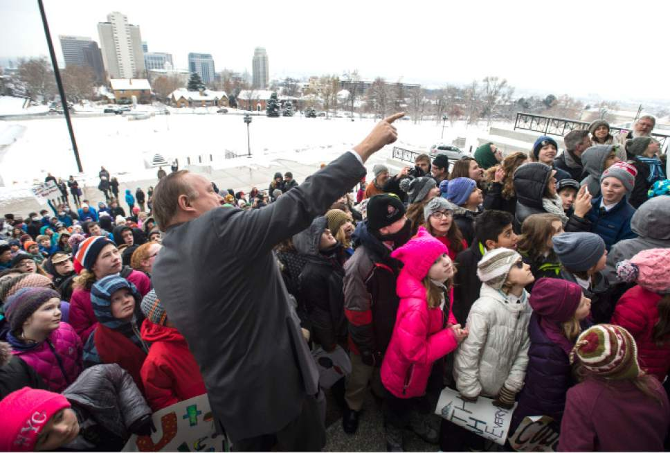 Steve Griffin / The Salt Lake Tribune  Sen. Jim Dabakis, D-Salt Lake City, points to the Governor's office in the State Capitol as he tells hundreds of Utah students from schools including the Choir School, Rowland Hall and Judge Memorial Catholic High School to direct their rally cries in that direction during a Clean Air Rally on the front steps of the State Capitol in Salt Lake City Thursday January 26, 2017. This is the third consecutive year students from the Choir School have aired their concerns about the excess smog as several students gave speeches to the group.