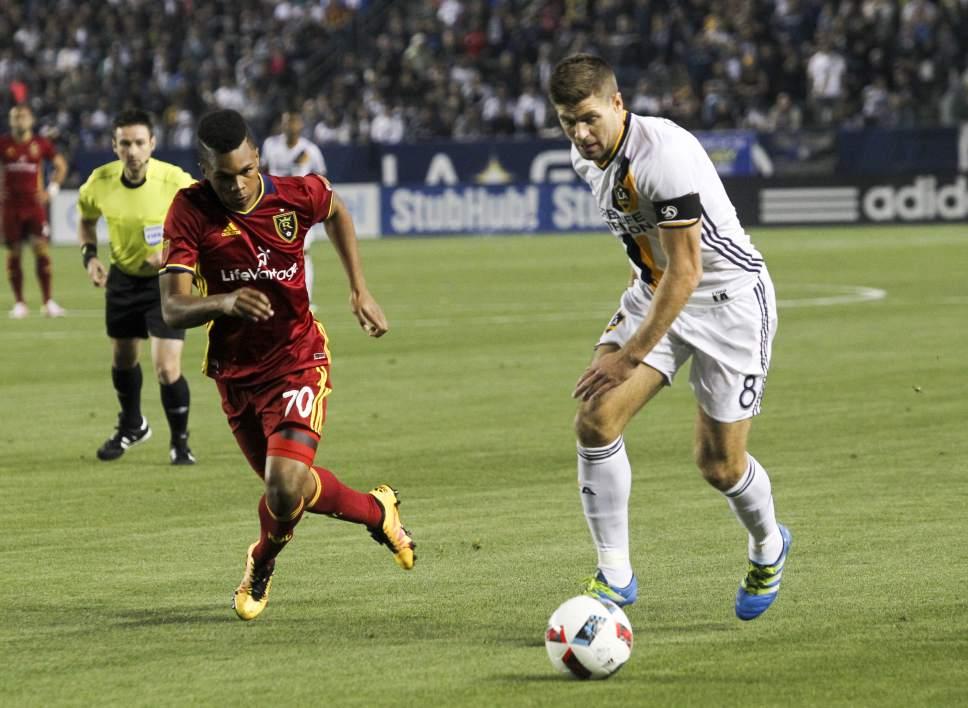 Real Salt Lake midfielder Jordan Allen (70) and Los Angeles Galaxy midfielder Steven Gerrard (8) in actions in the first half of an MLS soccer game in Carson, Calif., Saturday, April 23, 2016. (AP Photo/Ringo H.W. Chiu)