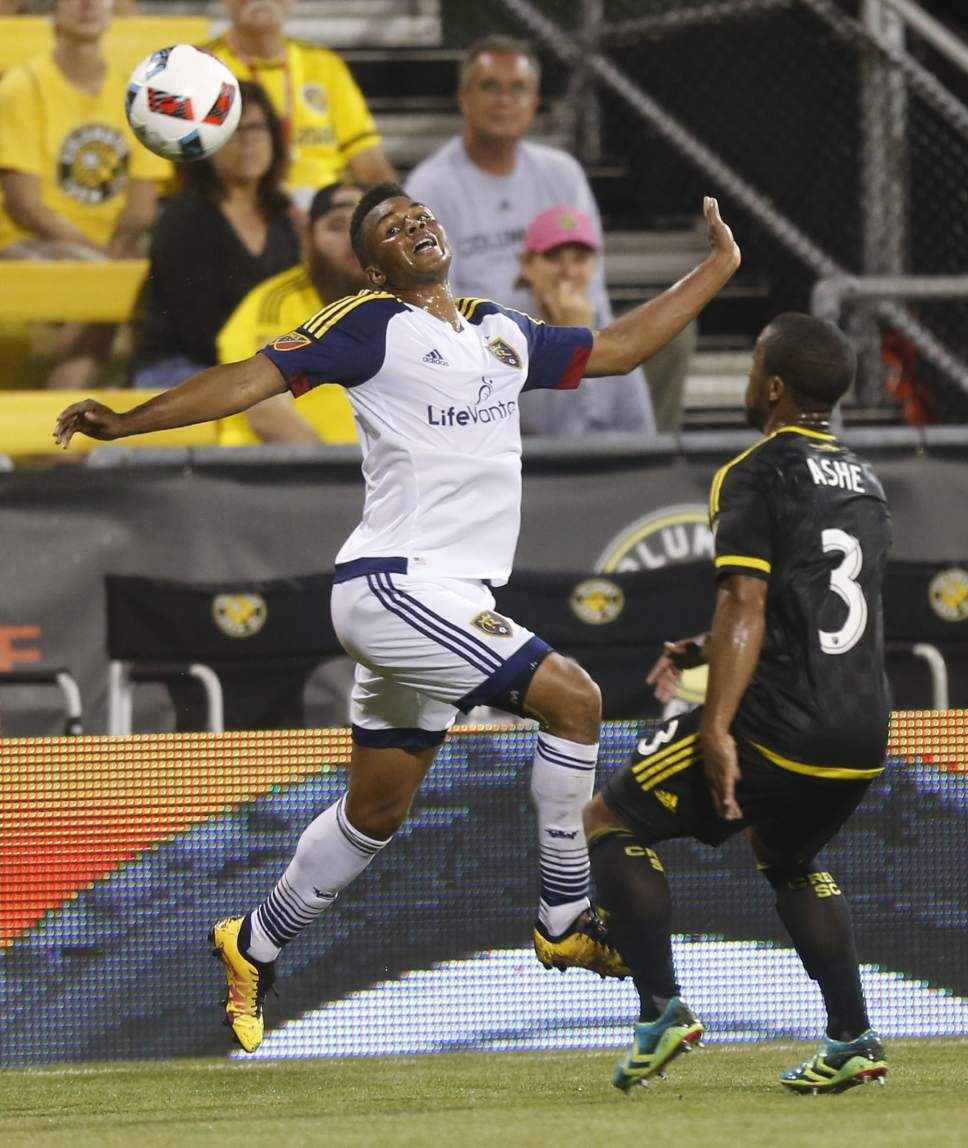 Real Salt Lake midfielder Jordan Allen, left, heads the ball away from Columbus Crew defender Corey Ashe during the first half of an MLS soccer match Saturday, May 28, 2016, in Columbus, Ohio. (AP Photo/Jay LaPrete)
