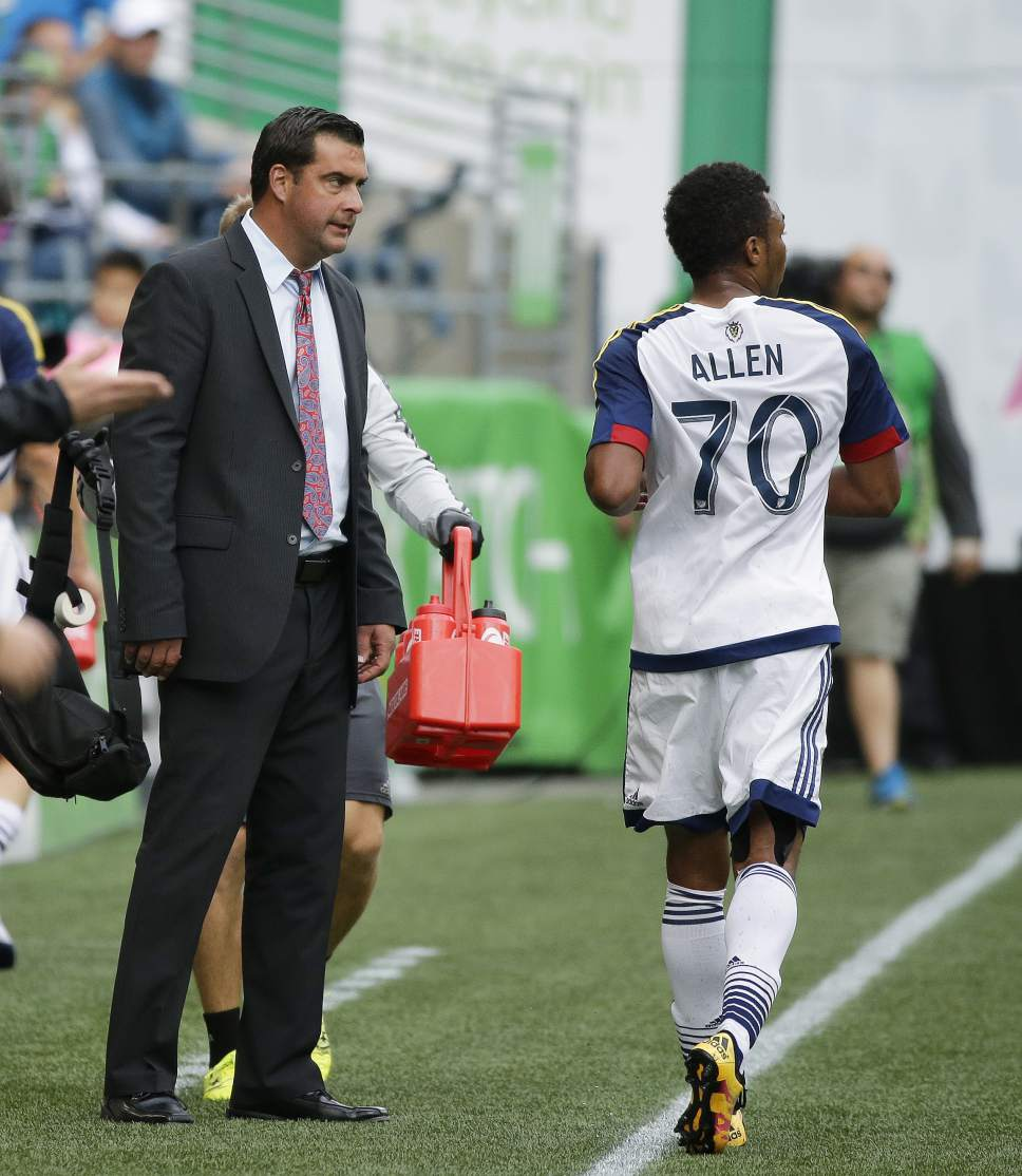 Real Salt Lake head coach Jeff Cassar, left, talks with midfielder Jordan Allen (70) while trainers tend to an injury on the field during the second half of an MLS soccer match against the Seattle Sounders, Sunday, Oct. 23, 2016, in Seattle. (AP Photo/Ted S. Warren)