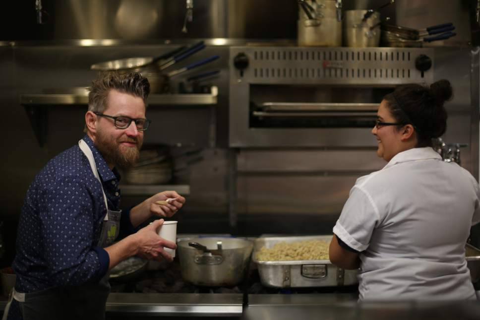 "Celebrity chef Richard Blais tastes the rye spaetzle before ""An Artist at the Table"" fundraising dinner in Kamas. Courtesy  