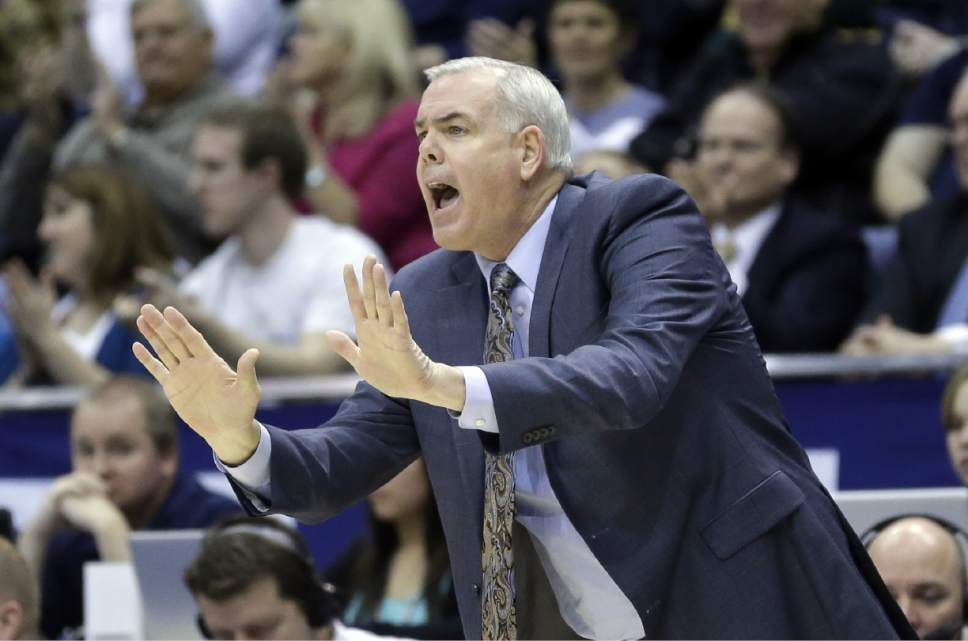 Brigham Young head coach Dave Rose shouts to his team in the first half of an NCAA college basketball game against Gonzaga Thursday, Feb. 20, 2014, in Provo, Utah. (AP Photo/Rick Bowmer)