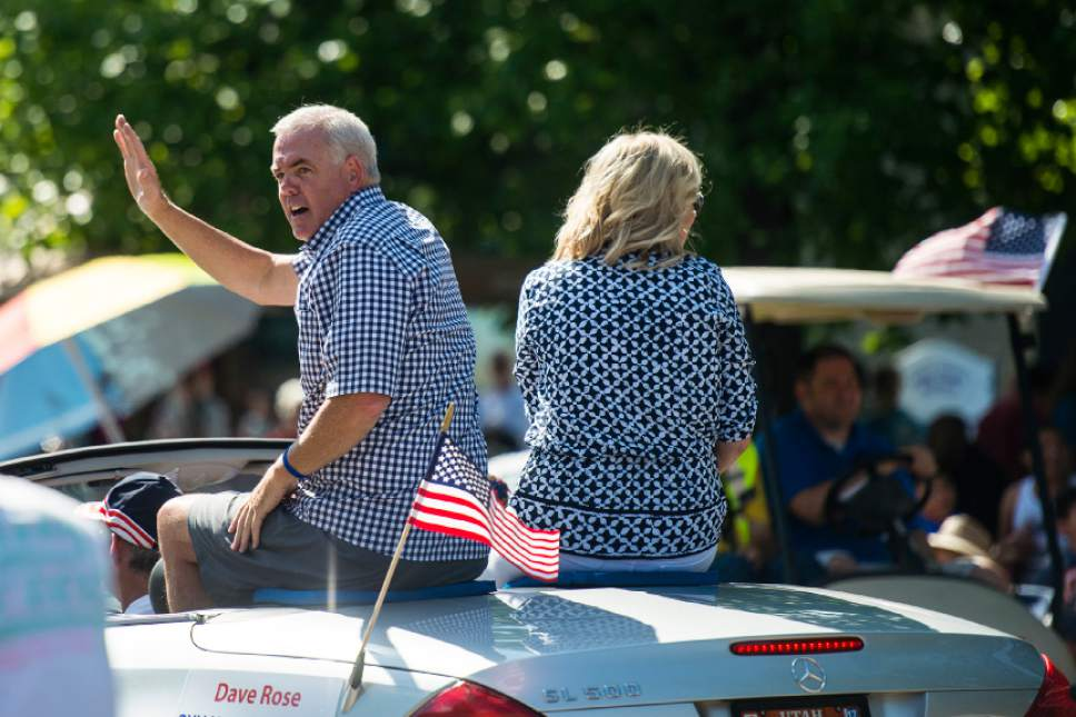 Chris Detrick  |  The Salt Lake Tribune BYU basketball coach Dave Rose waves to the crowd during the annual Freedom Festival Grand Parade in downtown Provo Monday July 4, 2016.