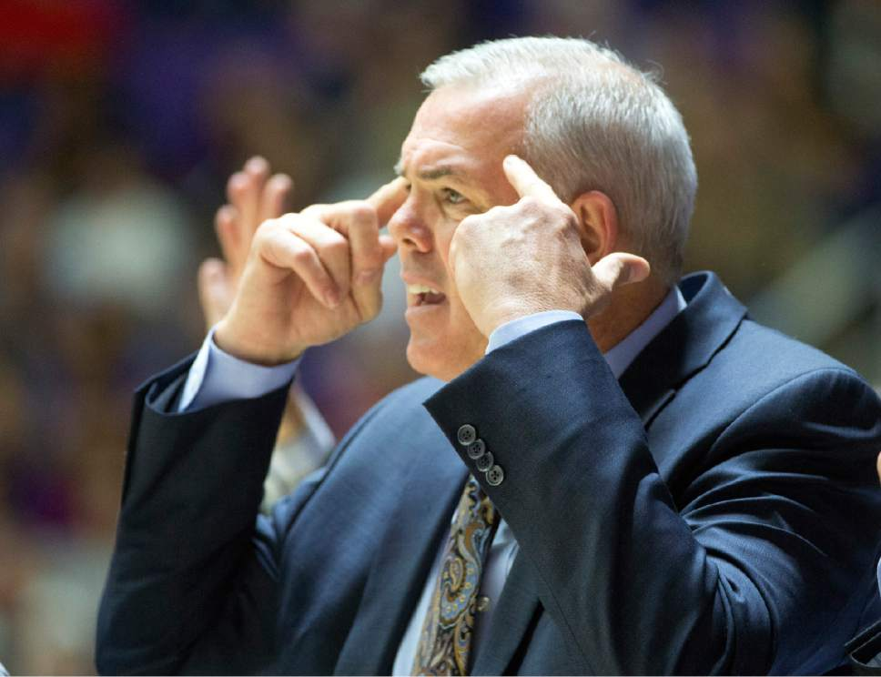 Rick Egan  |  The Salt Lake Tribune  Brigham Young Cougars head coach Dave Rose tries to keep his team focused on the game, in basketball action BYU vs Weber State, at the Dee Events Center in Ogden, Saturday, December 13, 2014