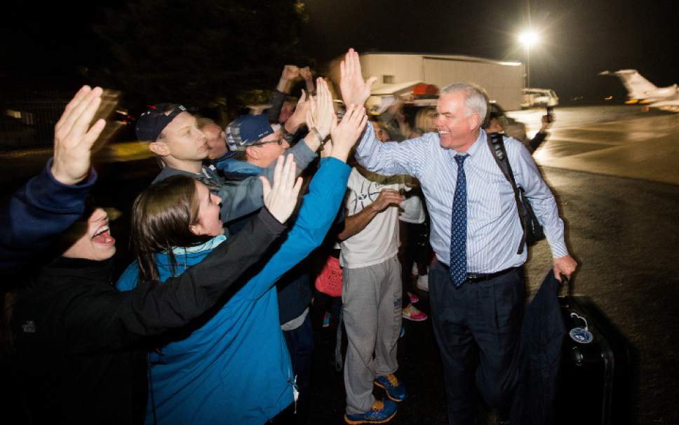 BYU Head Coach Dave Rose and  the BYU Men's Basketball Team were greeted by fans and members of the ROC Student Section at the Provo Airport after their upset win at #3 ranked Gonzaga. March 1, 2015  Photo by Jaren Wilkey/BYU
