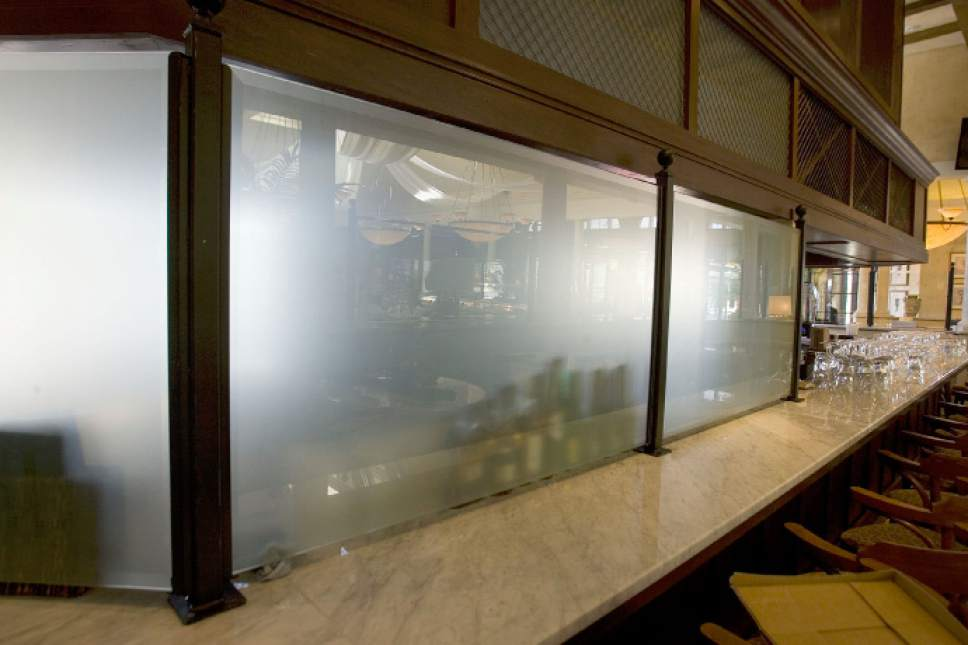 Tribune file photo A frosted glass curtain hides a portion of the bar at Brio Tuscan Grille at Fashion Place Mall.