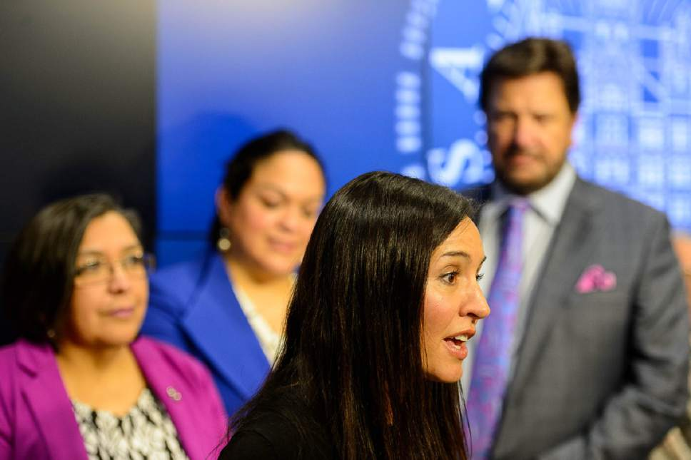 Trent Nelson  |  The Salt Lake Tribune ACLU attorney Marina Lowe speaks as House Democratic Representatives and Utah Latino Leaders, along with community activists, law enforcement, and others spoke against recent orders by President Donald Trump on immigration and refugee status. The press event took place at the Salt Lake City Public Safety Building, Thursday January 26, 2017.