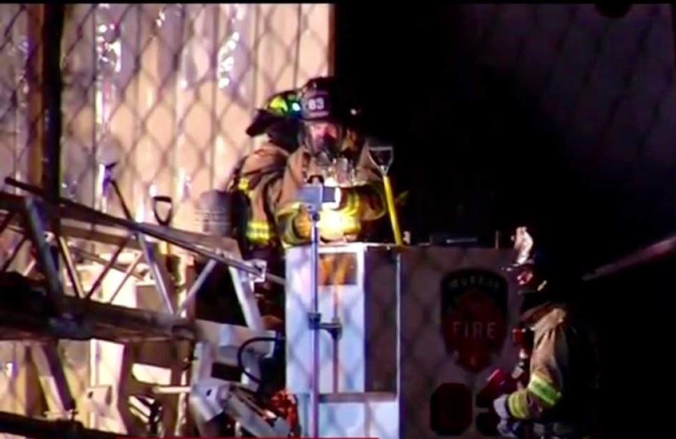 Courtesy of KUTV News   A four-alarm fire destroyed half of Sandy's snowplow truck fleet overnight and caused millions of dollars in damage.