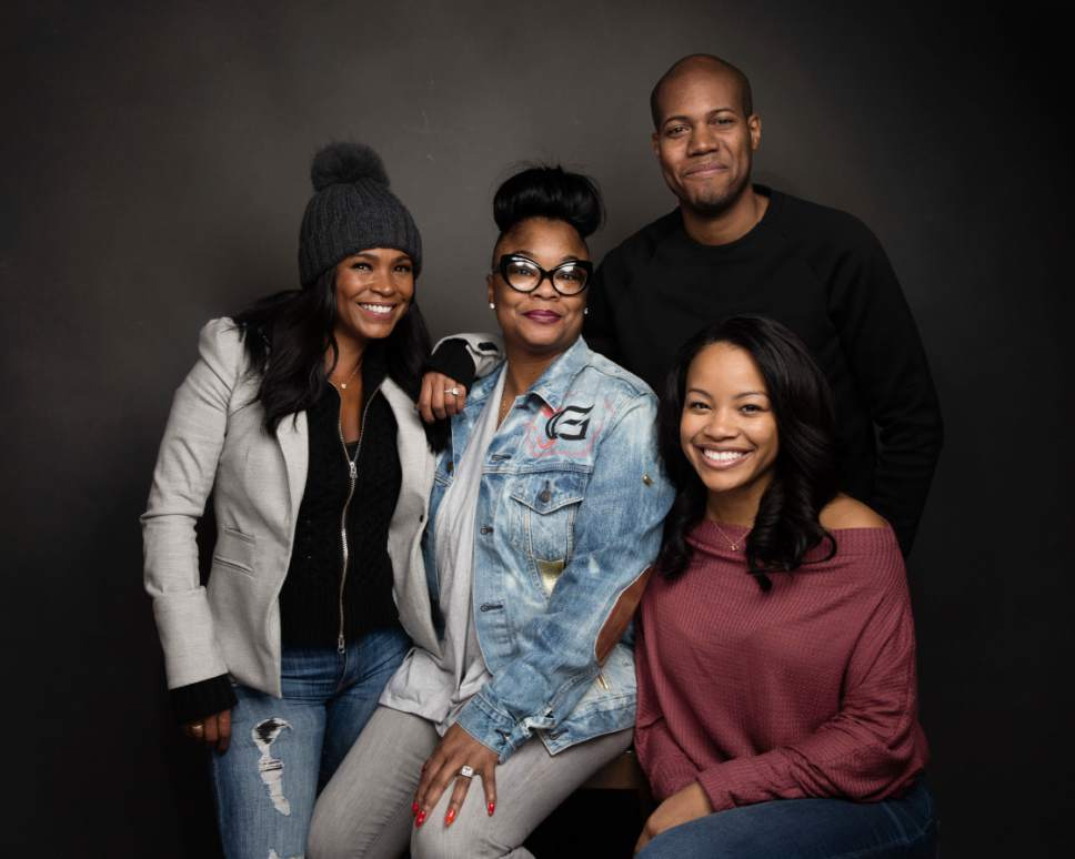 """Actress Nia Long, from left, Roxanne Shante, director Michael Larnell and Chante Adams pose for a portrait to promote the film, """"Roxanne Roxanne"""", at the Music Lodge during the Sundance Film Festival on Saturday, Jan. 21, 2017, in Park City, Utah. (Photo by Taylor Jewell/Invision/AP)"""